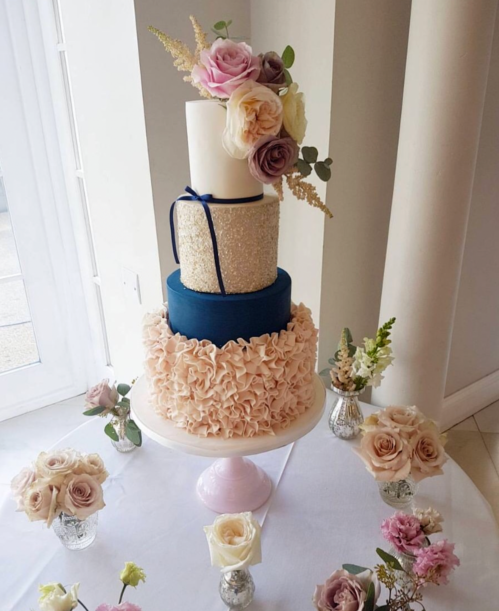 DOTTY ROSE WEDDING CAKE DESIGN NAVY AND BLUSH 4 TIER RUFFLED.png