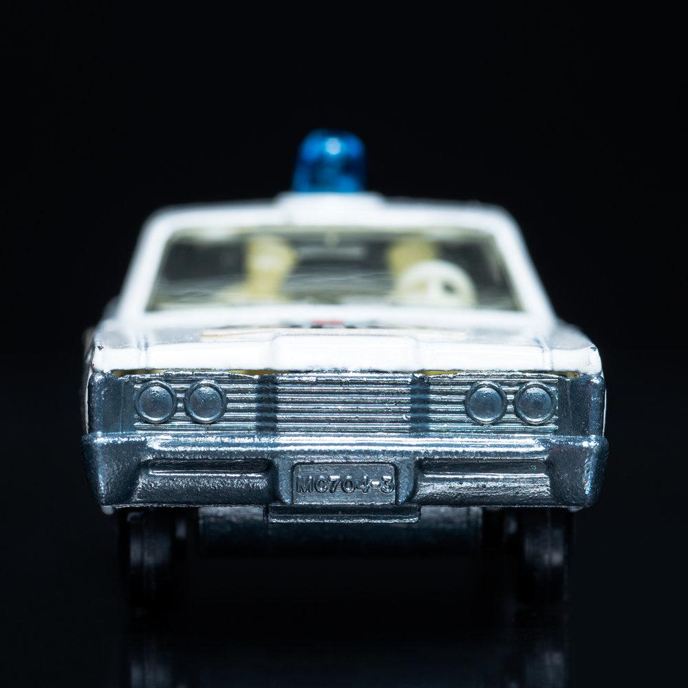 Mercury White Police Car