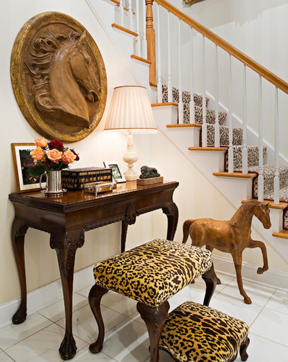 Wooden side table with horse sculpture and staircase