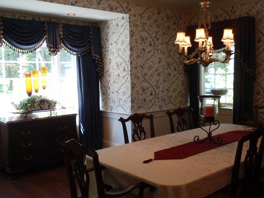 Dining area with vintage chandelier and blue curtains