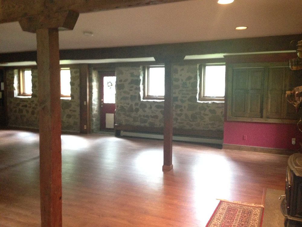 Empty room with stone style walls with wooden floor