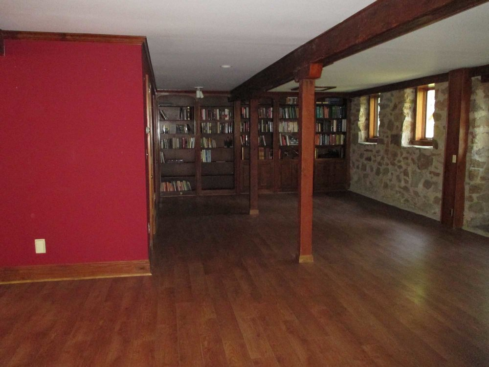Mini library with stone style wall and wooden floor