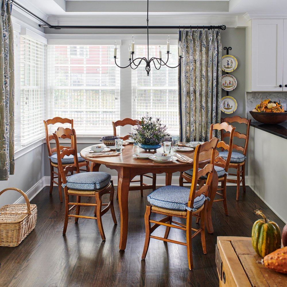 Wooden breakfast table with cushioned chairs