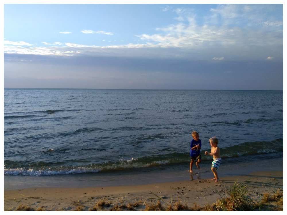 My boys enjoying Caseville's shoreline on Lake Huron during a camping trip.