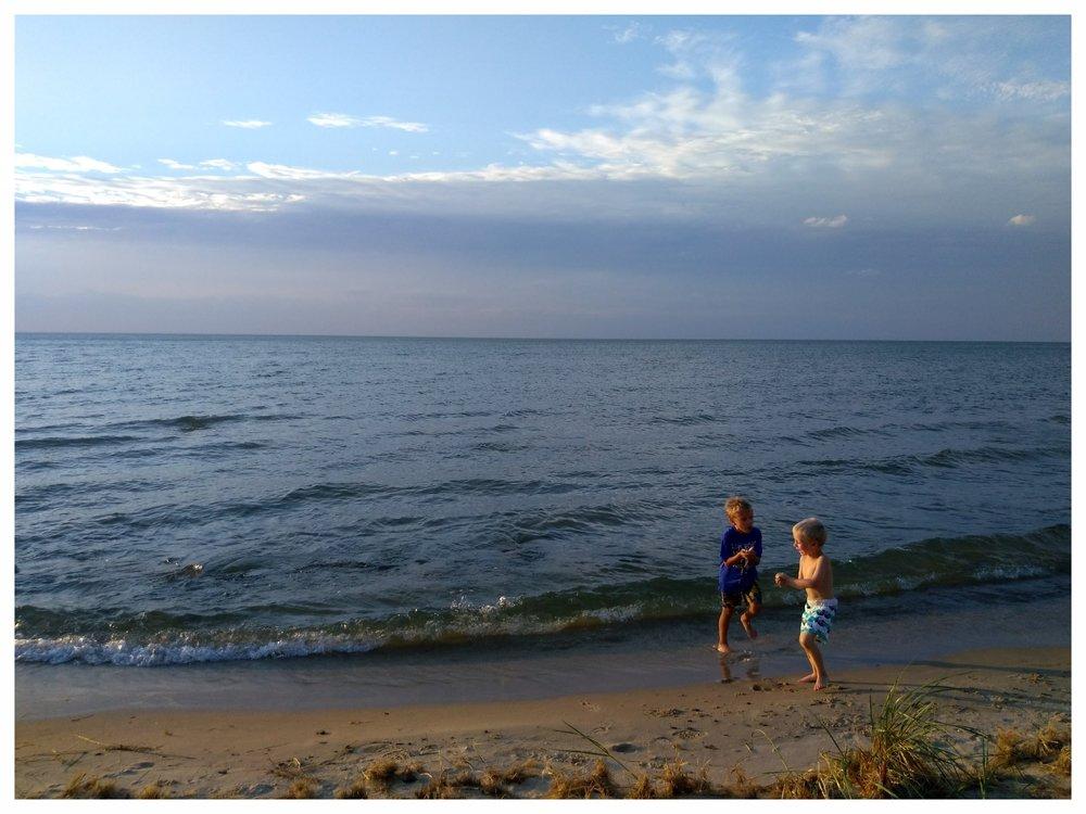 My boys enjoying Caseville's shoreline on Lake Huron during a camping trip.