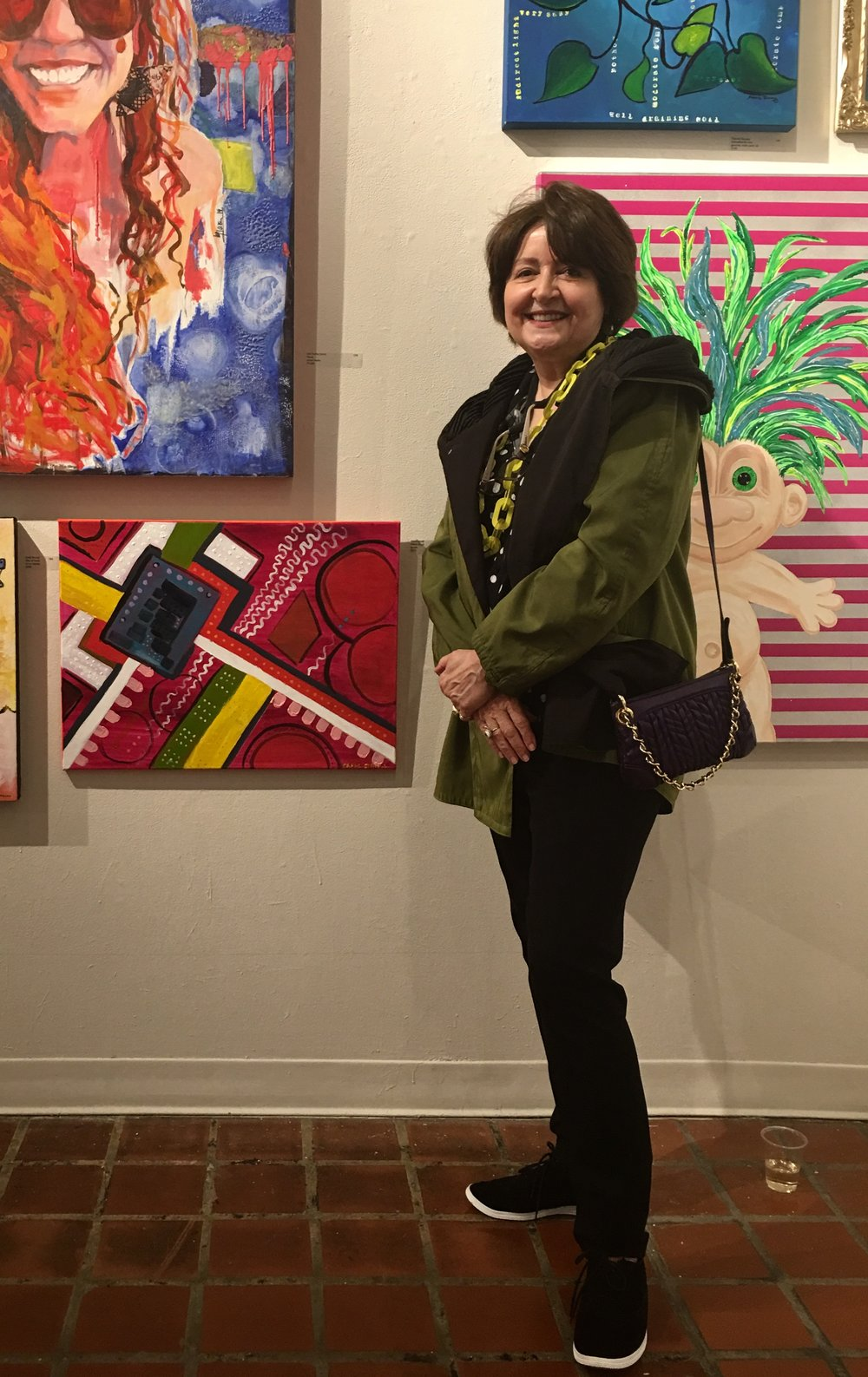 """Me and my painting tonight (May 17, 2018) at the Pre-Jury Viewing Party for the exhibition FRESH at ArtSpace. Mine is at the lower left in the photo, and presently is located in the first floor exhibition room at ArtSpace. It is called """"Which Way,"""" 18 x 24, acrylic on canvas and will show at ArtSpace through May 26. After that, Jennifer Dasal, Associate Curator of Contemporary Art at the NC Museum of Art, will select a few for an exhibition running June 1-29. I'm not counting on that, so if you want to see my painting at ArtSpace, get there by May 26! Meanwhile, all work sold raises funds for the ArtSpace Inspiration Fund - at least 50% of the proceeds of sales. And all work in the preview show, whether juried in or not, is already available for sale at  bit.ly/artspacefreshlook2018 . I enjoyed looking at over 200 donated works this evening."""