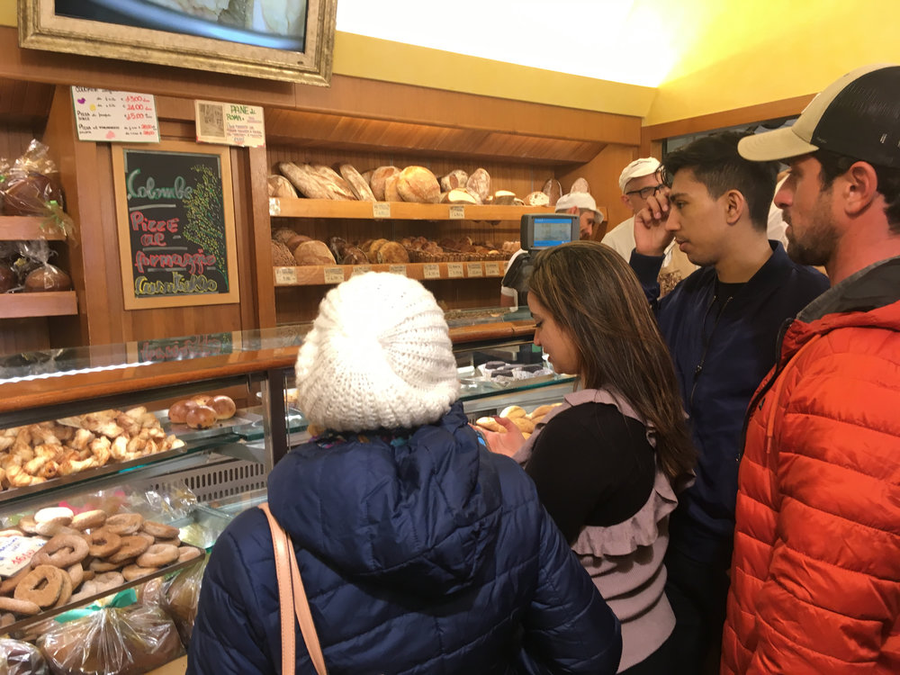 Golf-cart tour of Roma: Bakery stop at Forno Campo de' Fiori with guide Lorenzo (orange jacket)