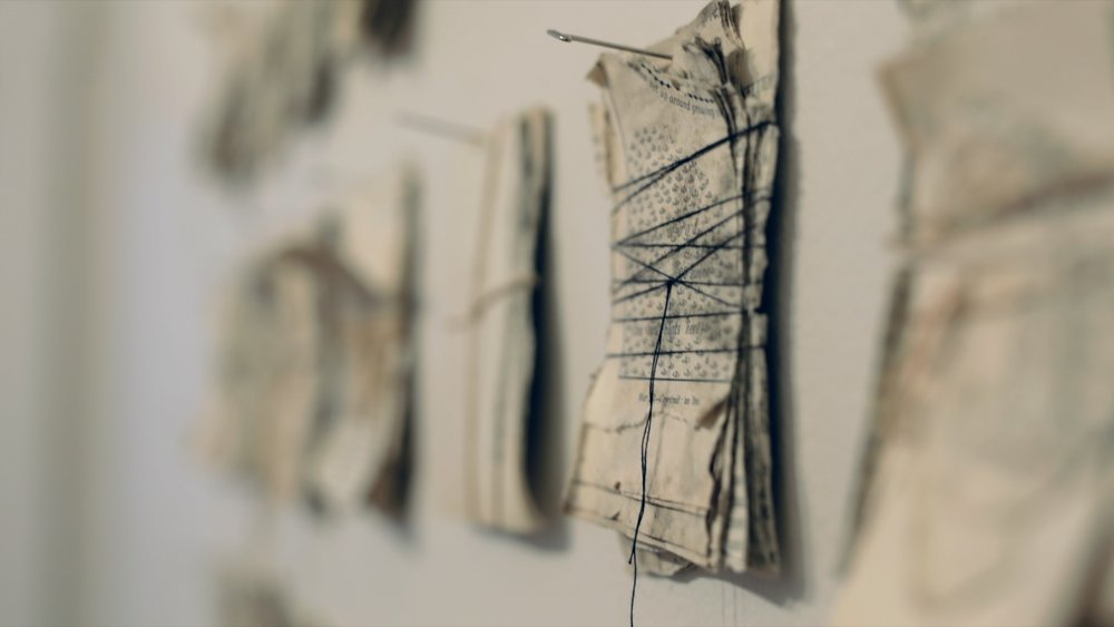 """History of England stacked and tied (1)  (detail) / book pages, beeswax, thread, string / individual pieces 11 cm x 7 cm (4.5""""x 3"""") assemblage size variable /   2018"""