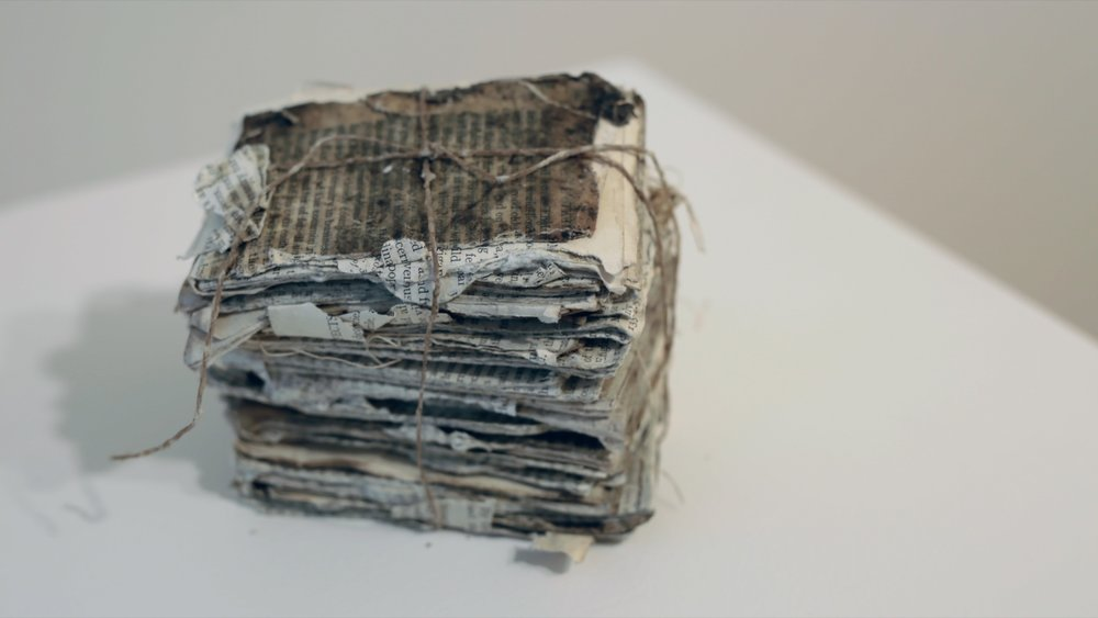 """History of England stacked and tied (2)  / book pages, beeswax, string / 11cm x 7 cm x 10 cm (4.5"""" x 3"""" x 4"""" ) / 2018"""