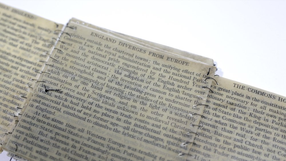 """History of England stitched and folded  (detail) / Book pages, beeswax, thread / 10 cm (4"""") x variable / 2018"""