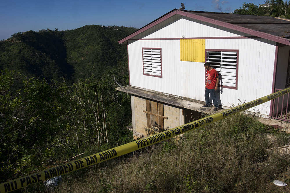 A home that now dangles off a cliff edge after a landslide.