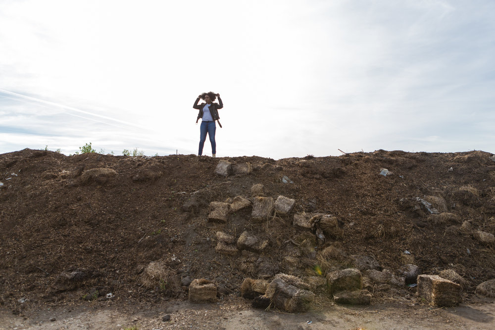 Pashon Murray photographed here on top of her Detroit Dirt project.