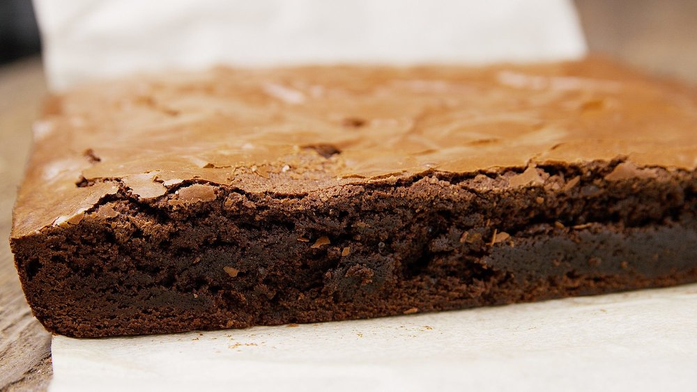 The key to the creamy fudgy interior - is to not over-bake the brownies.