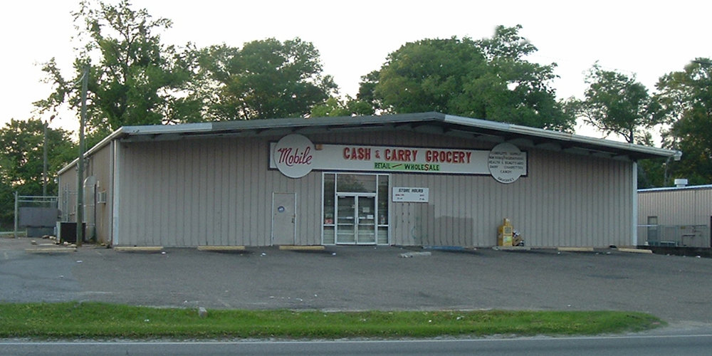 2406 Halls Mill Road - COMMERCIAL RETAILA 8,000± square foot Retail Grocery located on the north side of Halls Mill Road between Pleasant Valley Road and McVay Drive.The building is 100% occupied.Tenant: W.L. Petrey Company