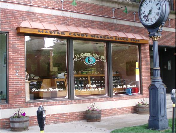 Glass and Copper Store front design of Ye-Goodie-Shoppe