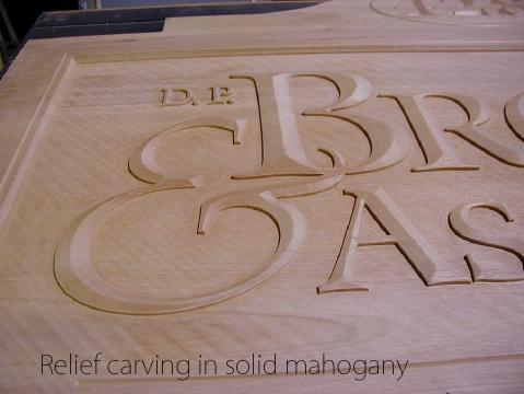 Relief carving in solid mahogany