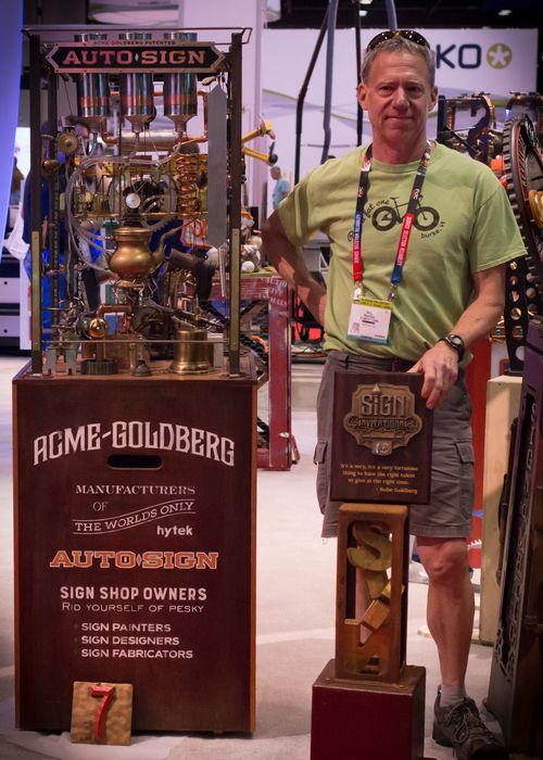 Peter Poanessa with the Acme Goldberg Auto sign award