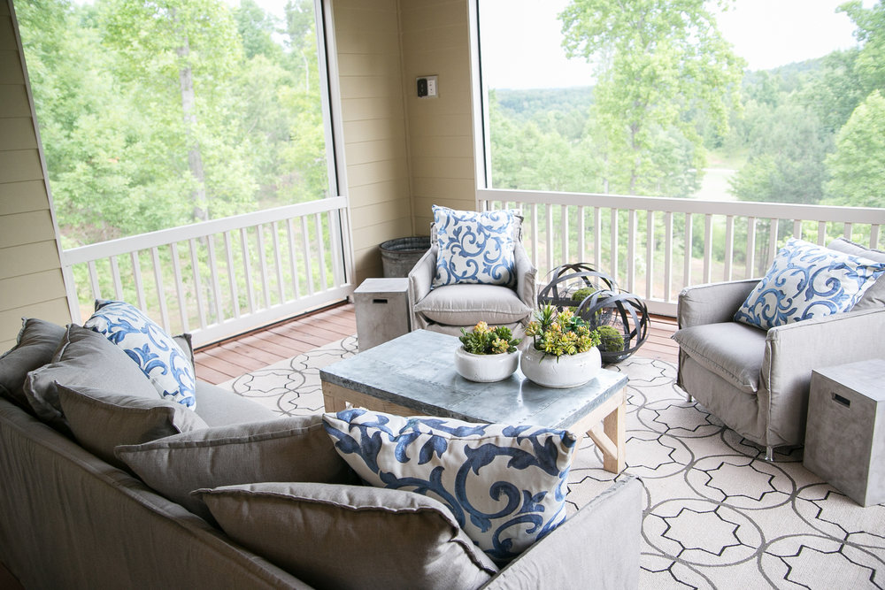 Screened porch creates perfect outdoor den with big mountain & golf views