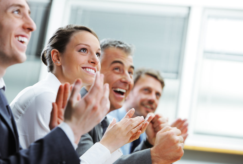 audinece clapping for presentation coaching.jpg