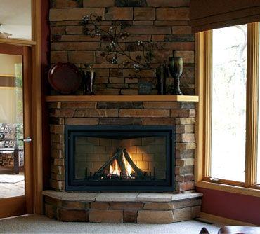 Living area fireplace stone surround white carpet.jpg