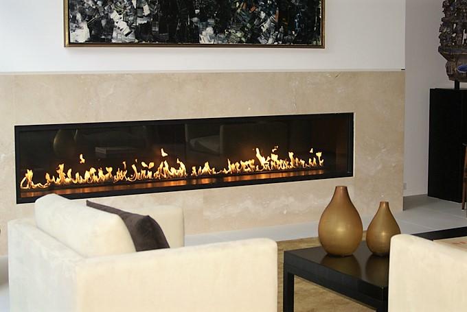 Living area fireplace Porcelain tile surrounf white tile floor.jpg