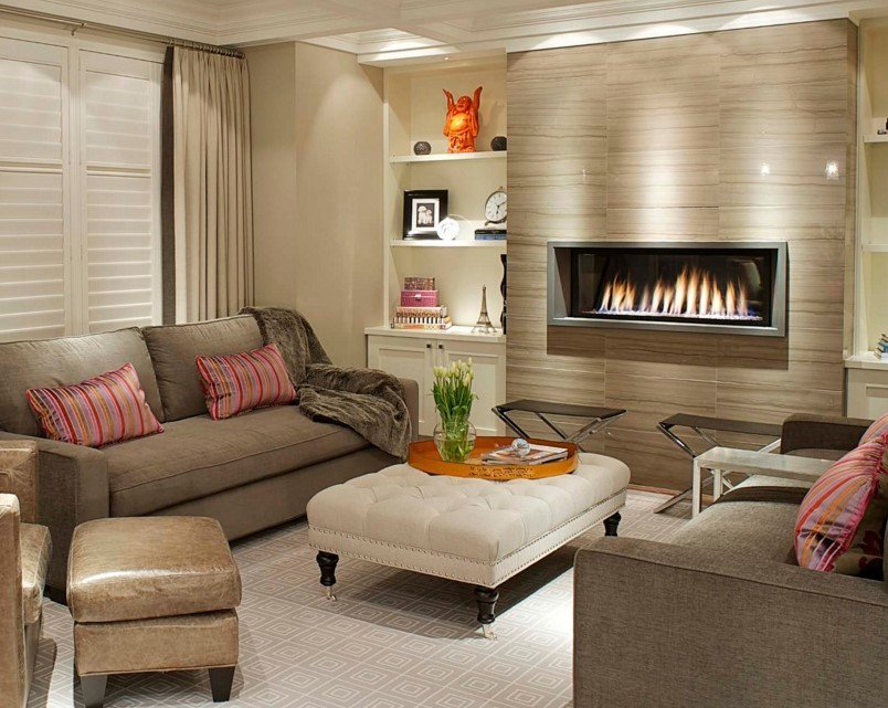 Living area fireplace stone wall surround carpet floor.jpg