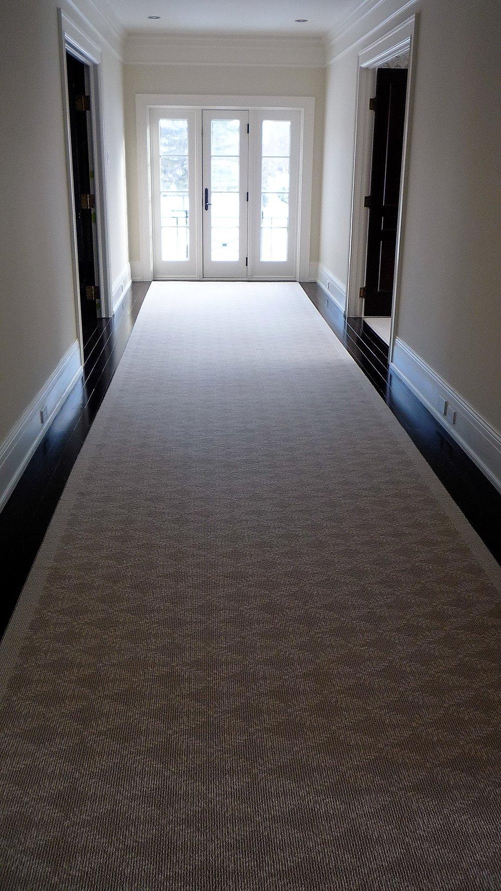 Living area hallway hardwood floors carpet runner.jpg