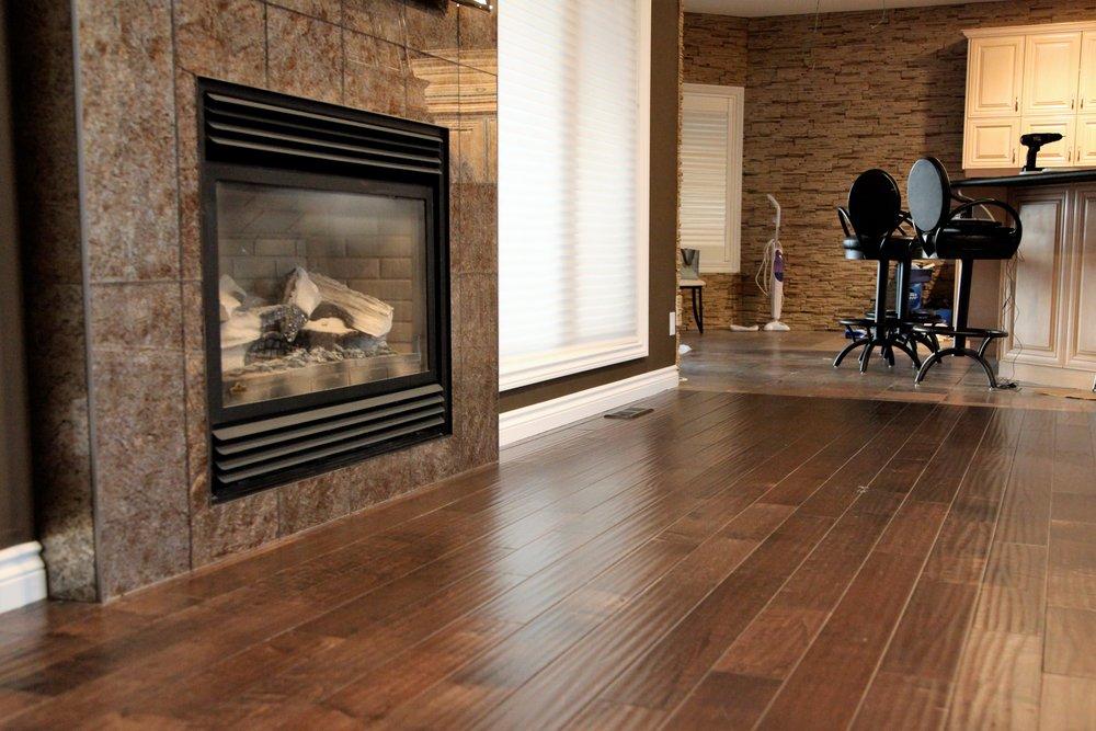 Living area hardwood floor fireplace surrounf.jpg