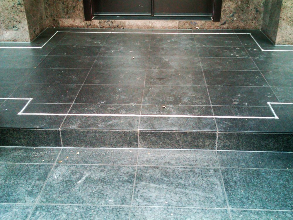 Outdoor patio stone tile front door.jpg