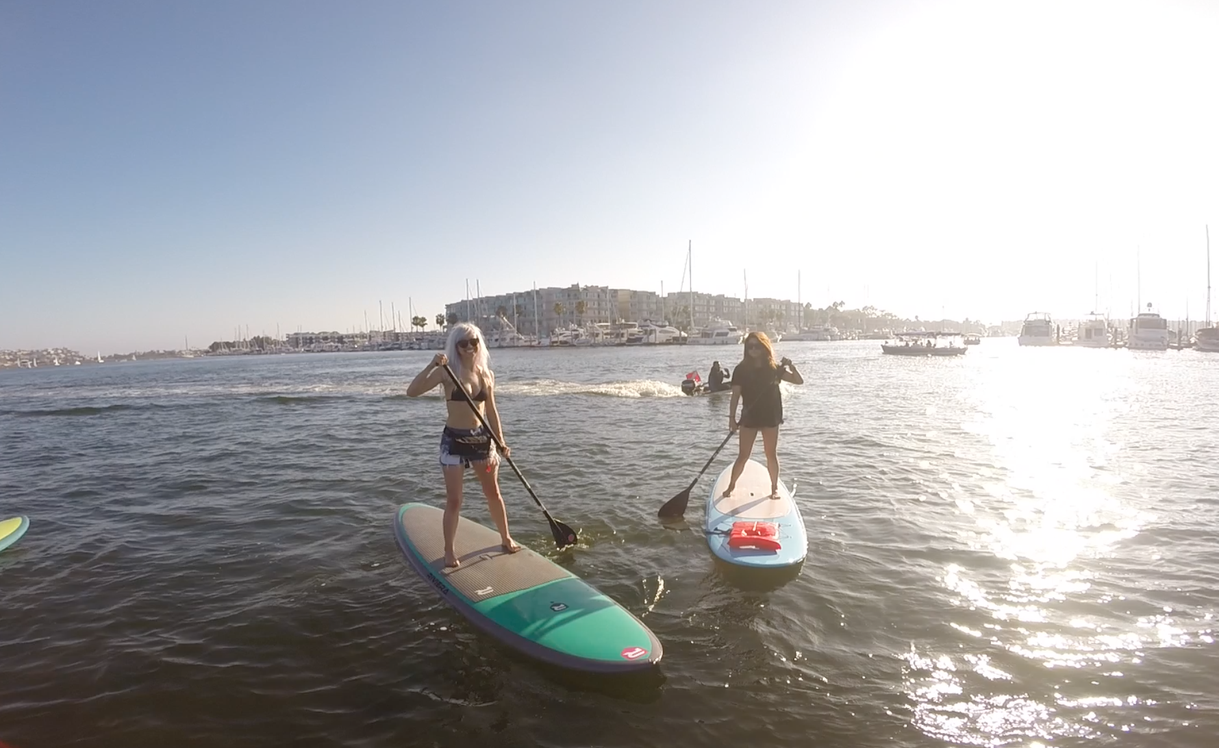 Holly and Vivian paddleboarding