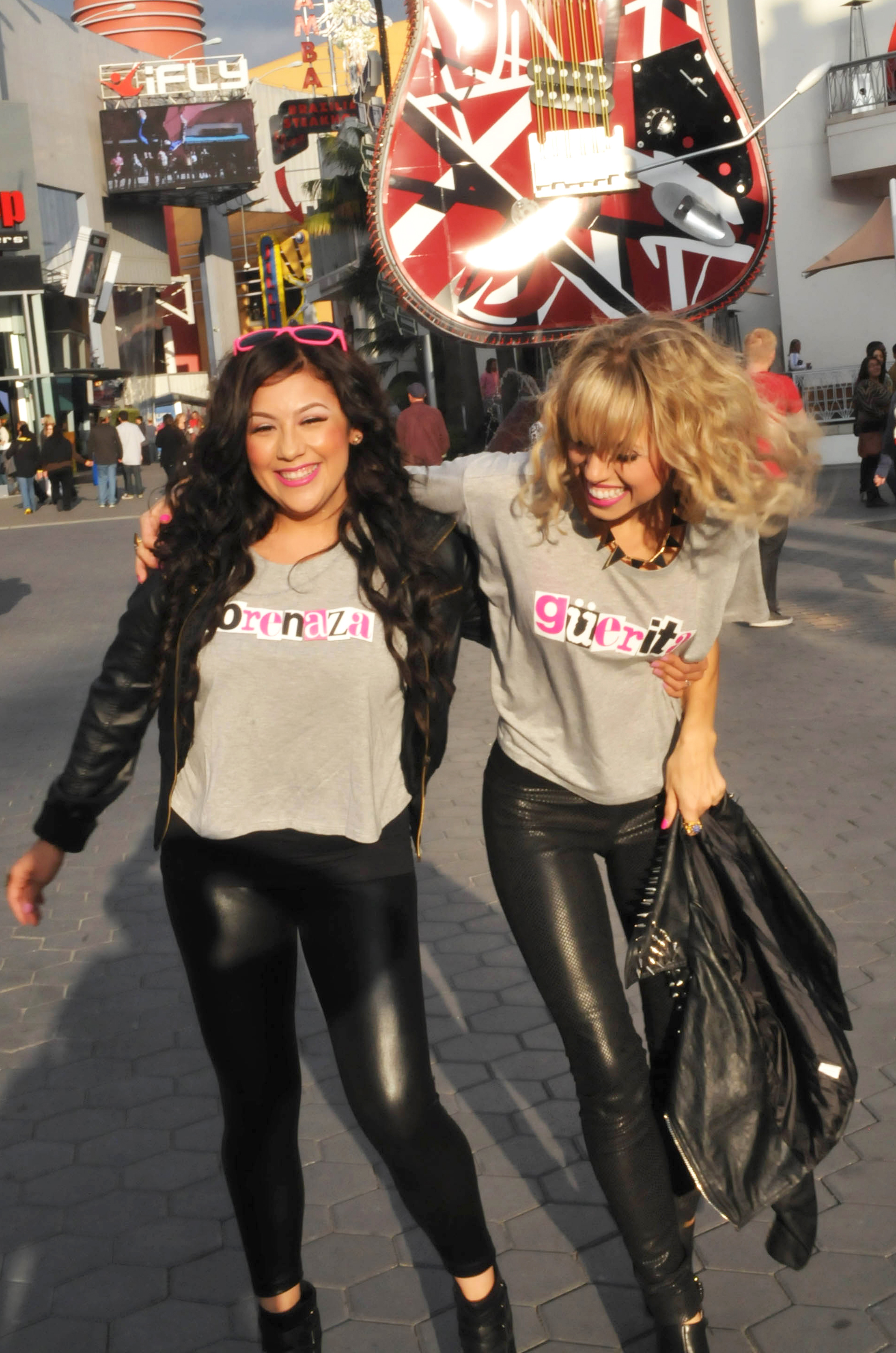 Nelly Azarcoya and Holly Tuggy modeling güerita and morenaza shirts