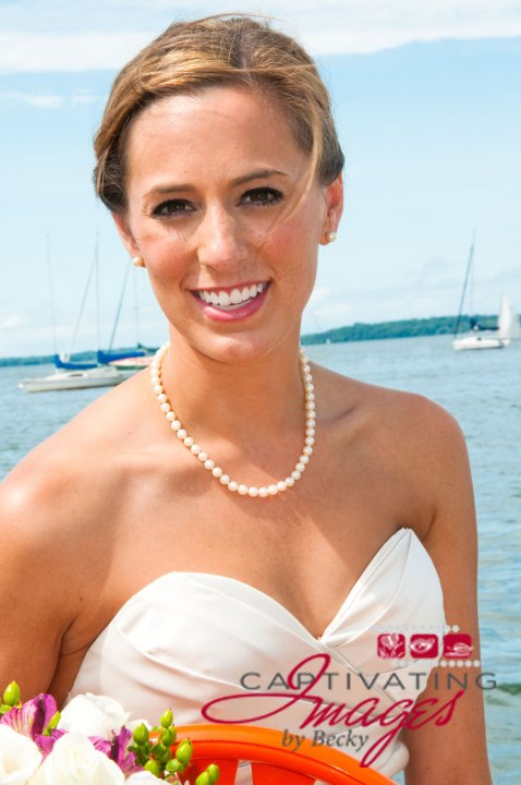 Jenna, my beautiful first bride who took a chance on me.  Also my first logo!  July 23rd, 2010