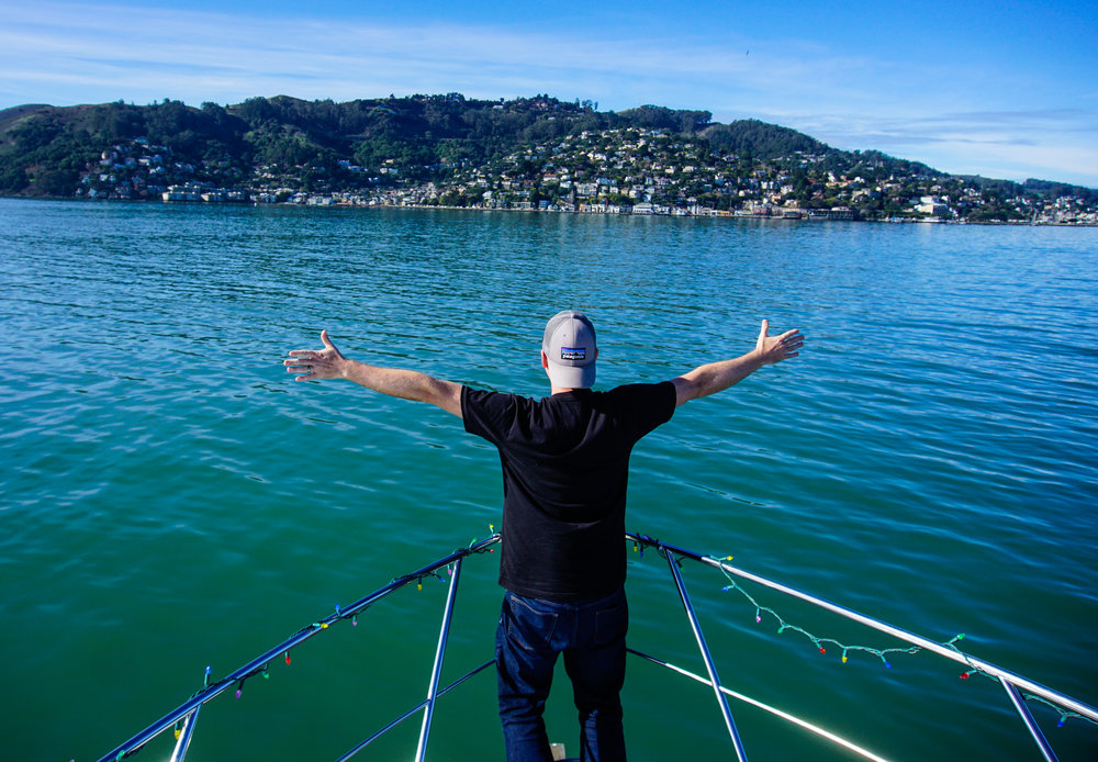 Brian's either taking in the view from the best spot on our boat or reenacting that scene from Titanic. Maybe both?