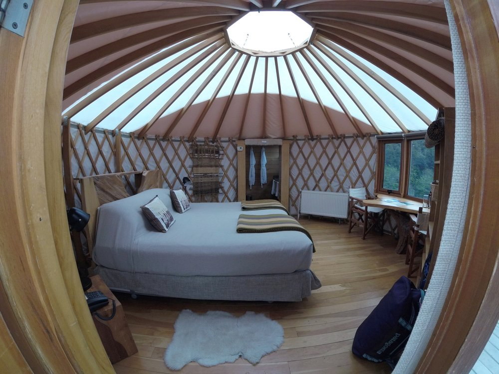 Each yurt has a radiator, attached bathroom, and tons of cozy blankets.