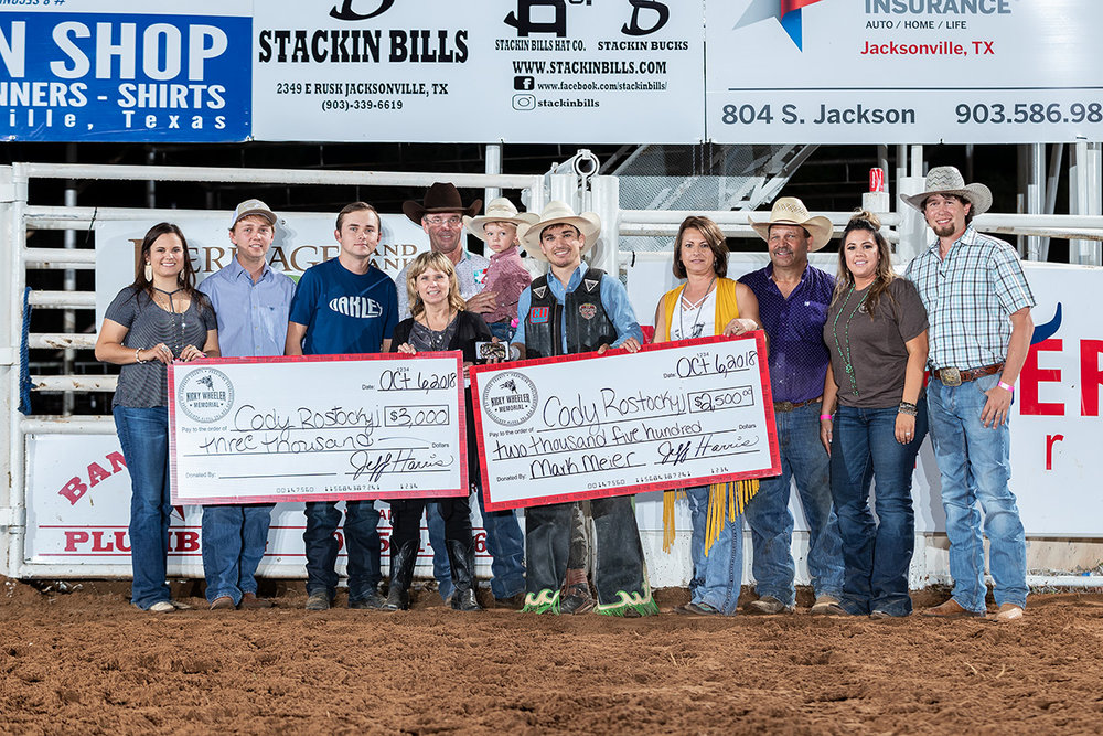 The Wheeler, Beasley, and Harris families with event champion Cody Rostockyj and Tuff Hedeman