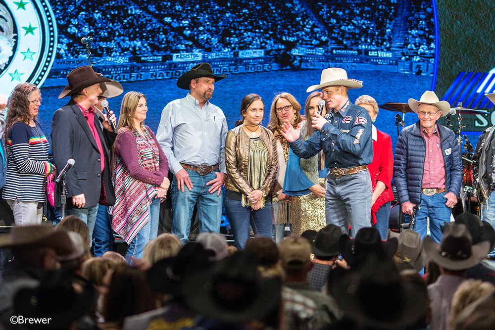 Flanked by Clyde and Elsie Frost, his wife Kylee and a host of special people in Joe's life, he accepts the Round 7 NFR win buckle at the South Point buckle ceremony in 2017.