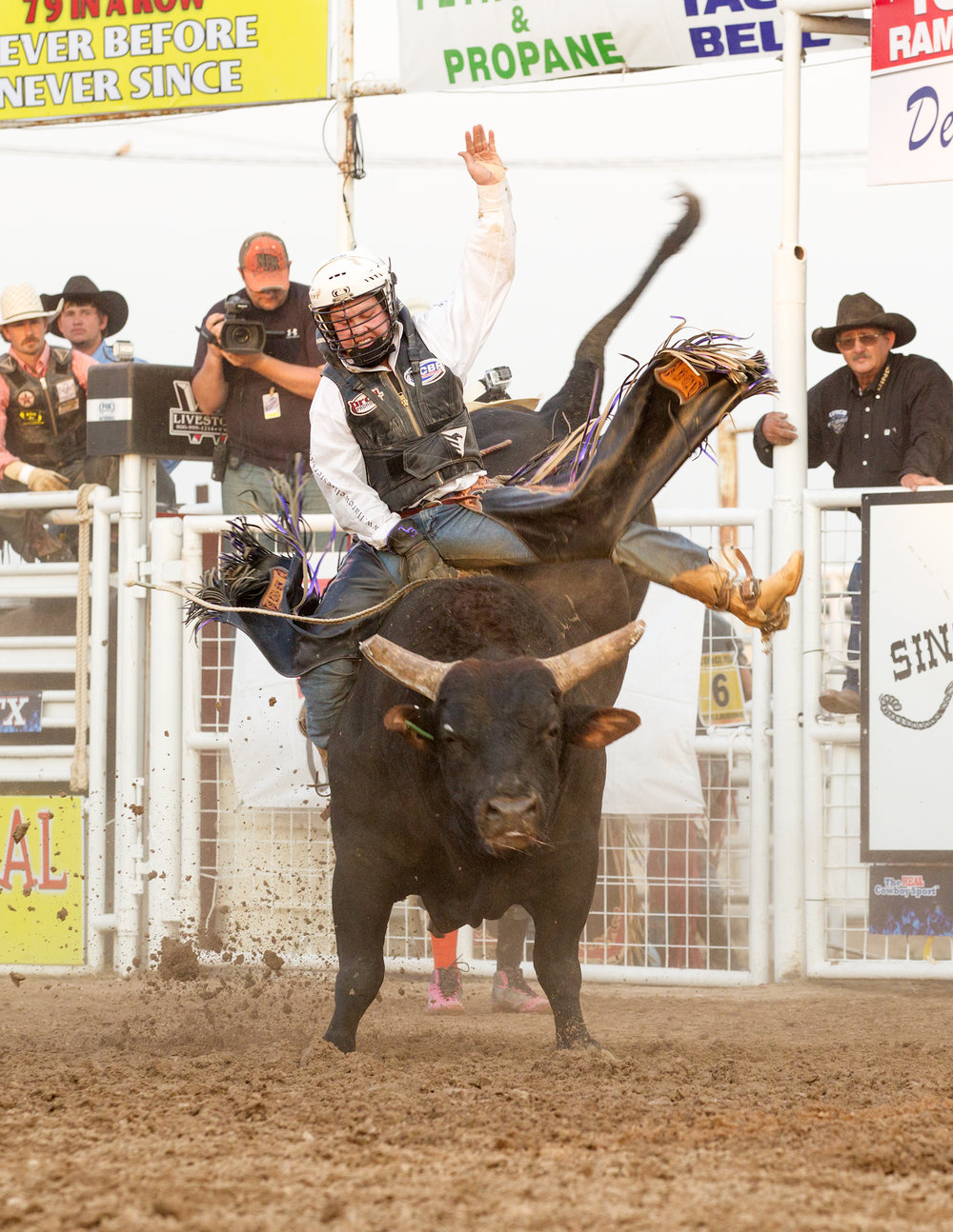 Benton riding Mike Rawson's 1380 Lumberjack at the George Paul Memorial Bull Riding circa 2013