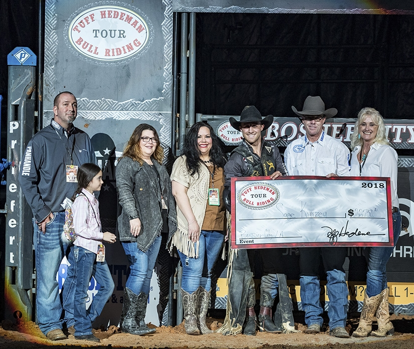 2018 Eldorado Tuff Hedeman Bull Riding Champion Sage Kimzey accepts the check from Tuff Hedeman