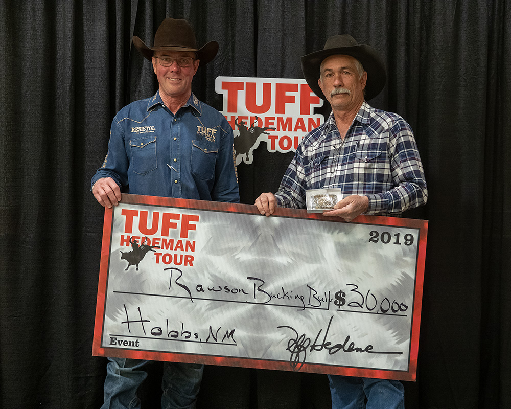 Tuff Hedeman presents $30,000 win check to Mike Rawson for the Bull Team competition in Hobbs. Rawson's trio of buckers won the title on three qualified rides.