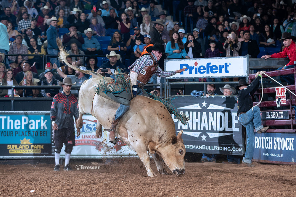 Idaho bull rider Brady Portenier plits the semifinal round win riding on 452 Tombstone for 90 points, Rawson Bucking Bulls.