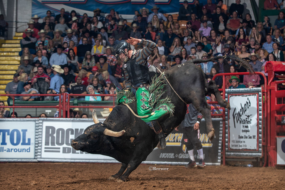 NFR qualifier Jeff Askey wins round one with 90 points aboard winning bull team member B7 Nightmare owned by Jerry Richardson, Richardson Land and Cattle Co.