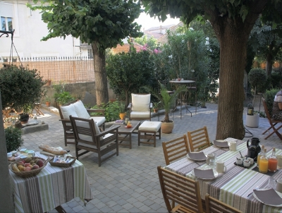 OUR FAMOUS BUFFET BREAKFAST IS SERVED AL FRESCO ON THE TERRACE UNDER THE TREES.