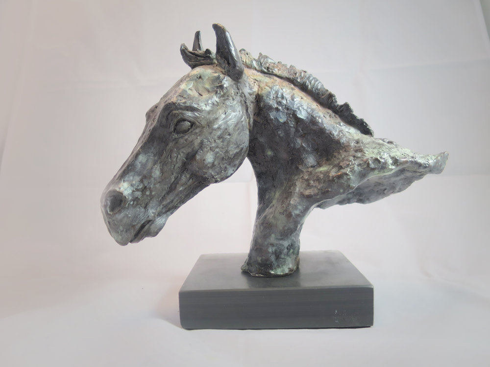 Uphill Edition 1/10 - SOLD - First edition of Uphill a beatuifully textured horse head sculpture. Finished in a Verdigris patina on Cornish slate. Standing at 9 inch high and 10 inch long.