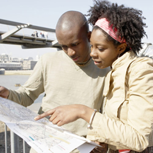 Couple looking into a map looking for the right direction