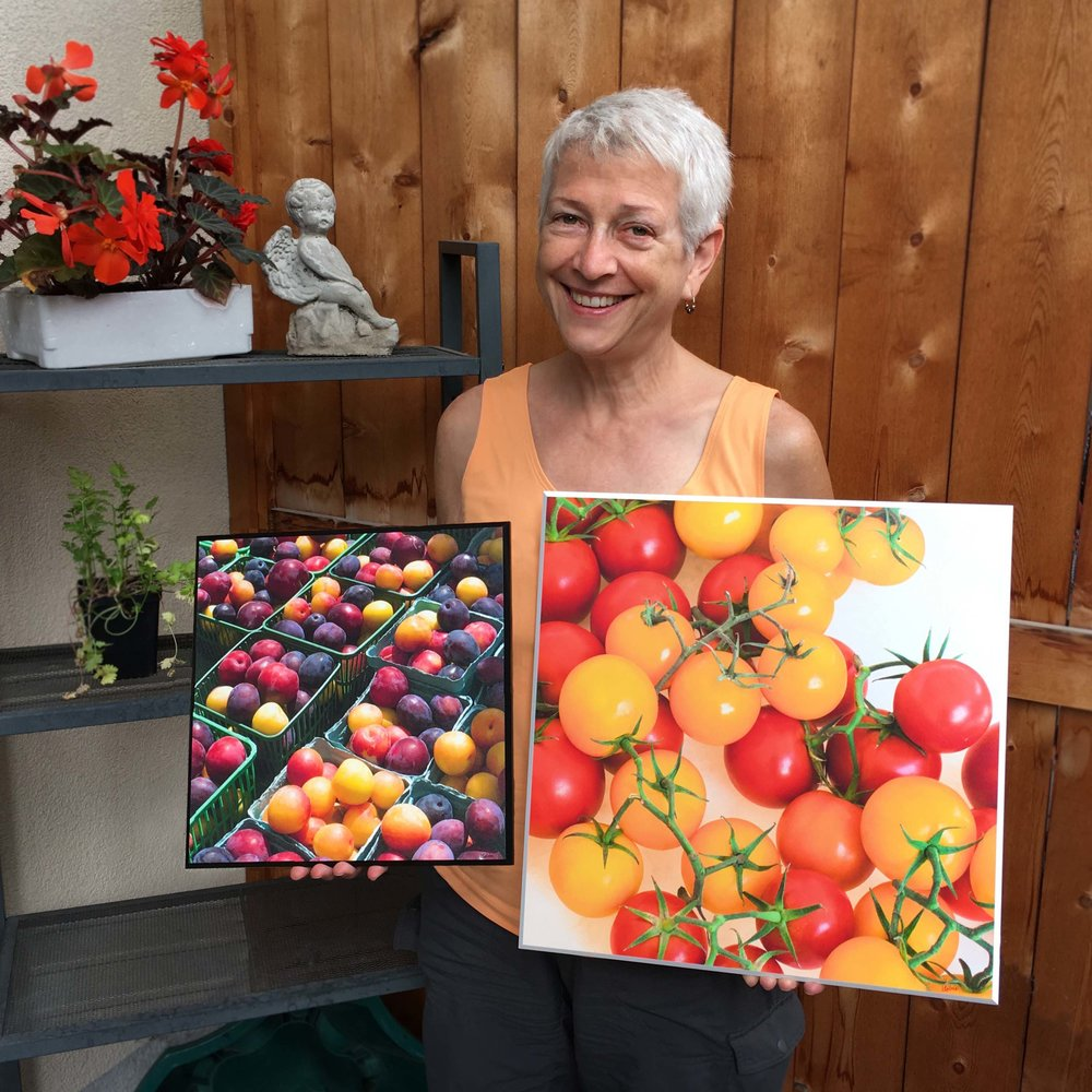 """Kitchen photo boards  shown here with beveled edge in white and black option. Note low-glare satin finish. Tomatoes 16x16"""" and plums 12x12""""."""