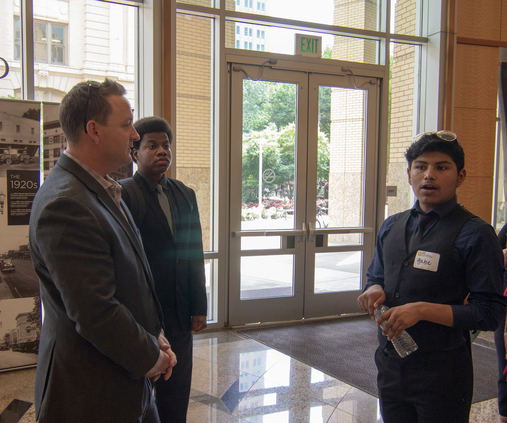 Hiram Johnson High School Principal Garrett Kirkland discusses a presentation with students.