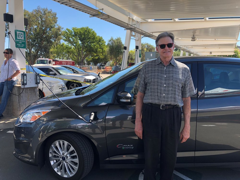 """""""Everyone who gets in my car wants to know all about it,"""" says Uber driver James Ashcraft, shown here with his Ford CMax."""