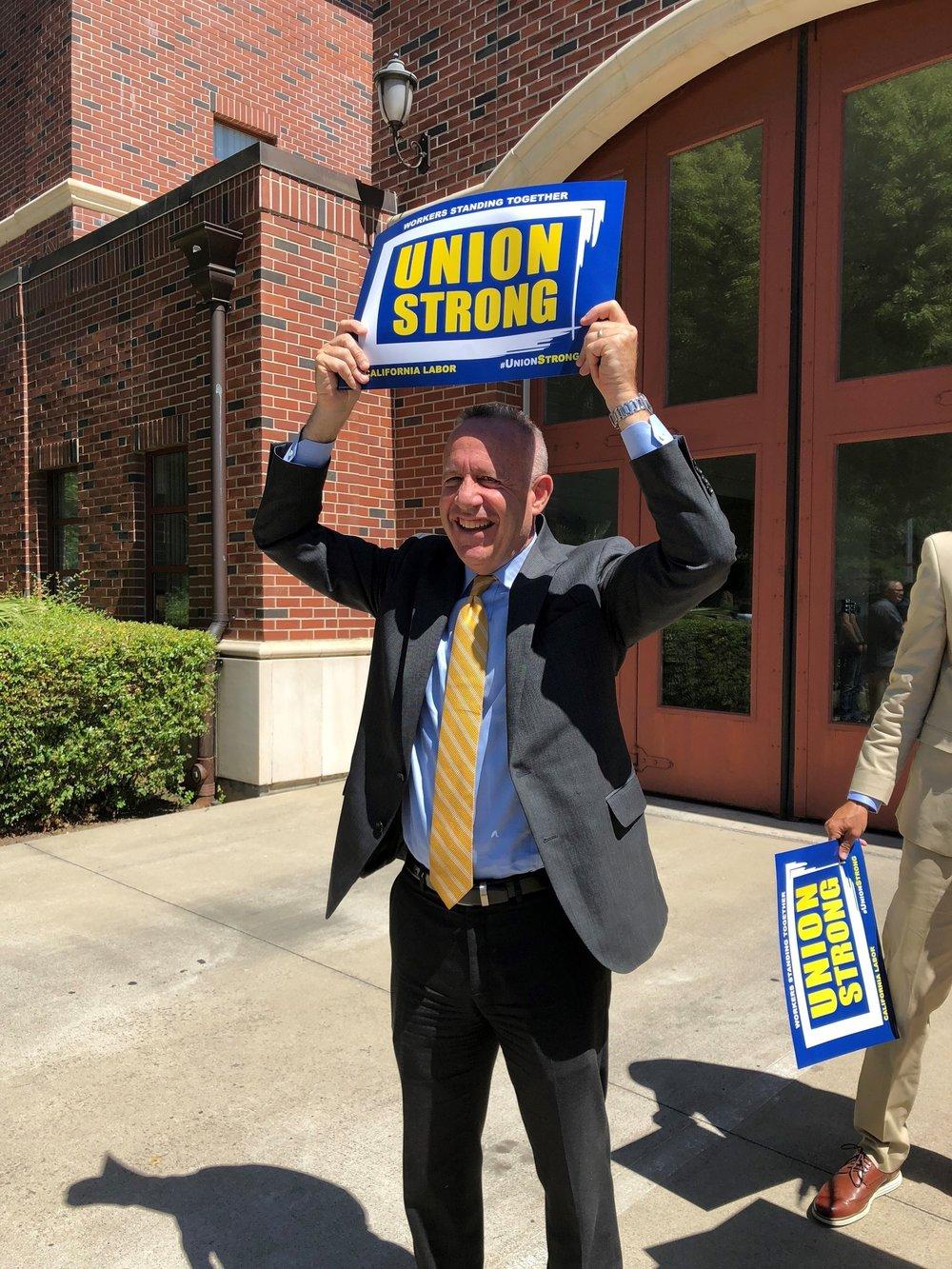 mayor with union sign.jpg