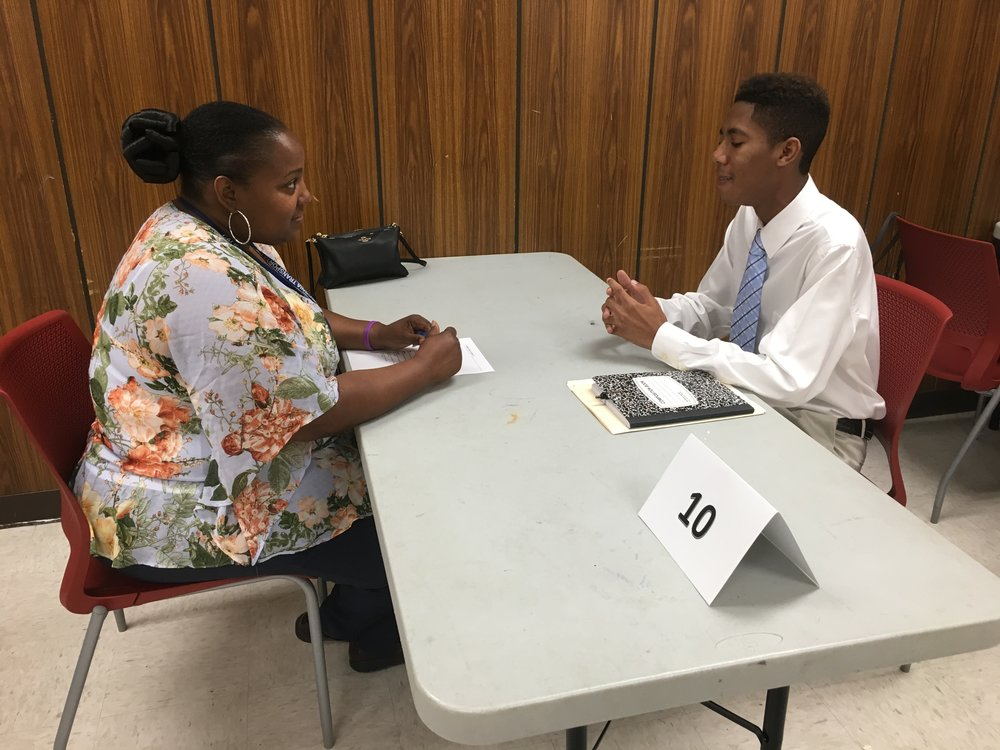 Student interviewing for Thousand Strong