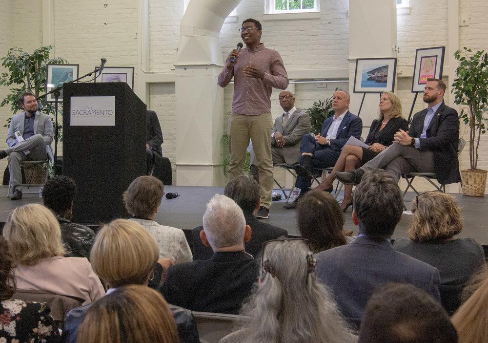 "Pleasant Grove High School graduate Chigozie Maduchukwu recites James Lasdun's poem ""It Isn't Me,"" at the announcement of the consortium effort in May 2018."